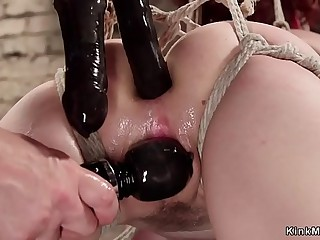 Gagged tied redhead rides ticklish horse